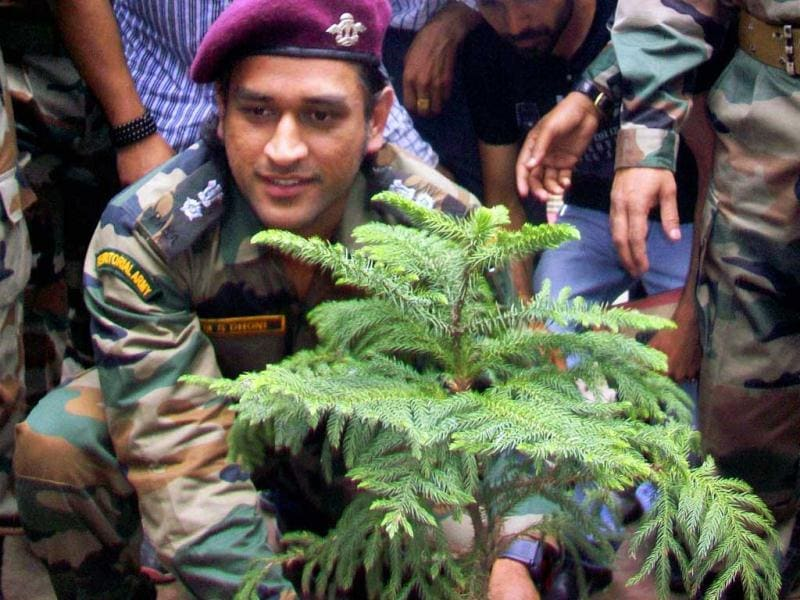 Lieutenant Colonel MS Dhoni, Indian cricket captain, plants a sapling during an interaction with the soldiers on the Line of Control (LoC) on Jammu and Kashmir's border with Pakistan, near Jammu on Saturday. (PTI Photo)
