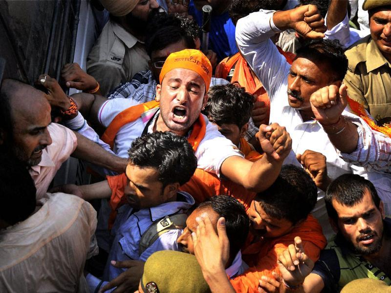 J&K Police detain Amarnath pilgrims and VHP activists during a protest, demanding the yatra to start early, in Jammu. PTI photo