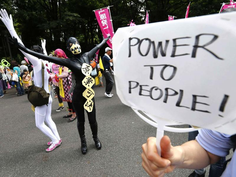 Protesters in costumes dance at a rally to demand the stop to all nuclear power reactors in Tokyo, Japan. Reuters/Kim Kyung-Hoon