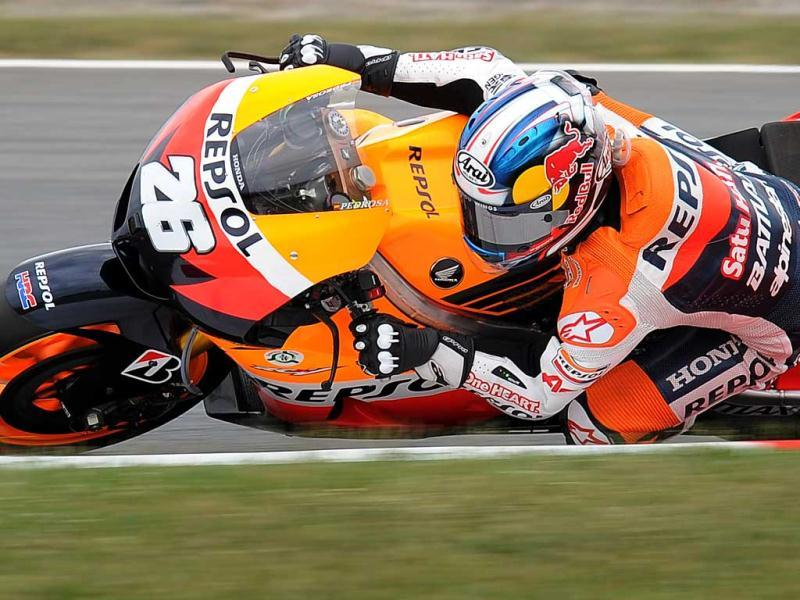 Repsol Honda Team's Spanish Dani Pedrosa rides during the MotoGP race of the Catalunya Moto GP at the Catalunya racetrack in Montmelo, near Barcelona. AFP/Lluis Gene