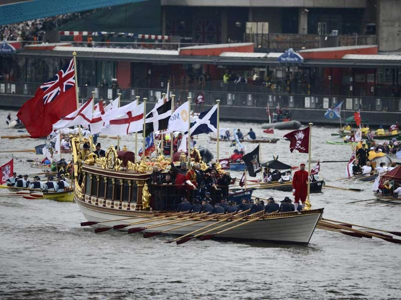 Boats of all shapes and sizes take part in a pageant near Tower Bridge in celebration of the Queen's Diamond Jubilee, along the River Thames in London. (Reuters/Dylan Martinez)