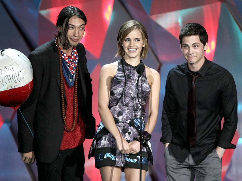 From left, Ezra Miller, Emma Watson, and Logan Lerman present the award for best male performance at the MTV Movie Awards in Los Angeles. AP/Matt Sayles
