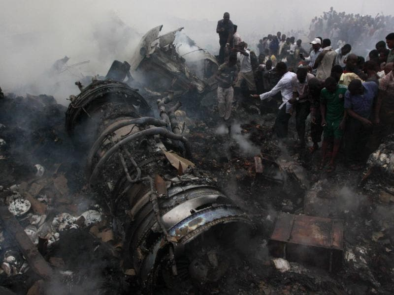 People gather at the site of a plane crash in Lagos, Nigeria. AP/Sunday Alamba