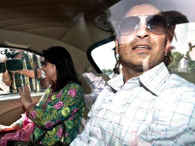 Sachin Tendulkar arrives in Parliament with his wife Anjali Tendulkar in New Delhi. AFP/Prakash Singh