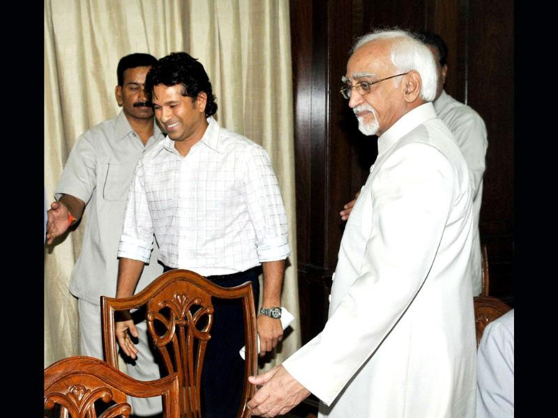 Master Blaster Sachin Tendulkar with vice president Hamid Ansari after taking oath as member of Parliament (Rajya Sabha) at Parliament House in New Delhi.