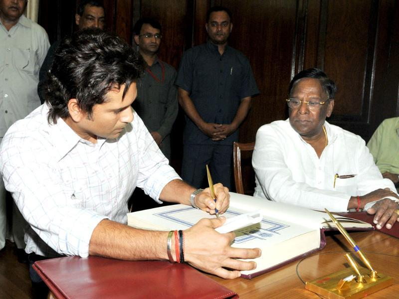 Master Blaster Sachin Tendulkar signs after taking oath as Rajya Sabha MP at Parliament House in New Delhi.