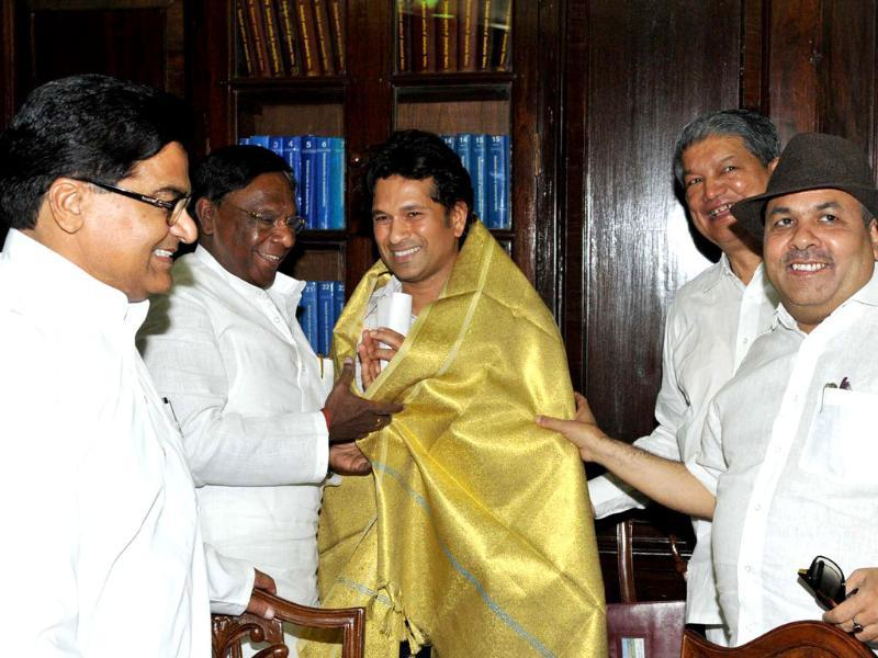 Sachin Tendulkar being honoured with a shawl by members of Parliament during the swearing-in ceremony at Parliament House in New Delhi.