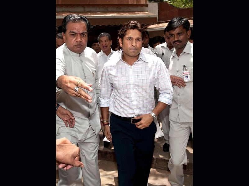 Sachin Tendulkar surrounded by security personnel leaves after addressing the media at Parliament in New Delhi. AFP/Prakash Singh