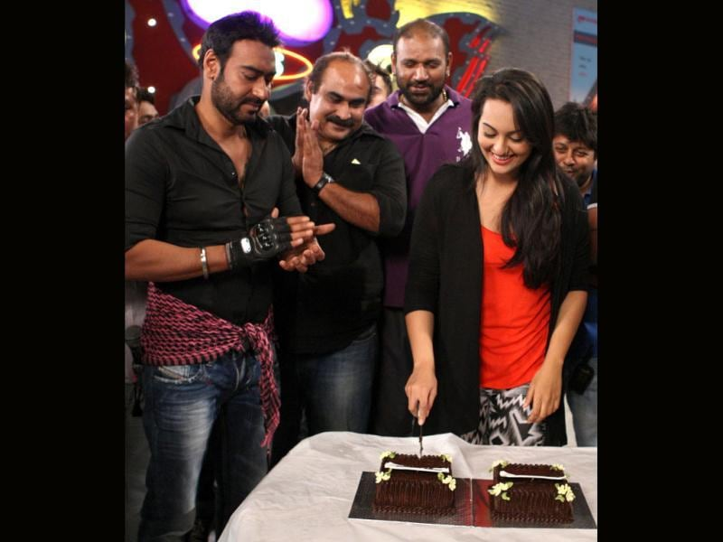 Sonakshi cuts the cake as the SOS team looks on.