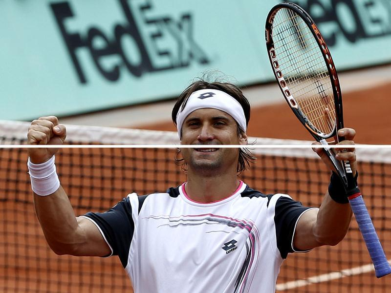 David Ferrer of Spain celebrates reaching the quarter finals after winning his fourth round match against Marcel Granollers of Spain at the French Open tennis tournament in Roland Garros stadium in Paris. AP/Bernat Armangue