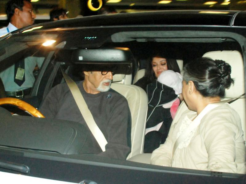 Aishwarya is all smiles as she holds Beti B in the backseat of the car. Amitabh and Jaya Bachchan, in the front seat look on.