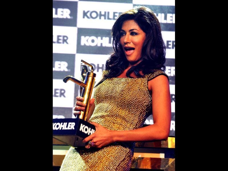 Chitrangada Singh gestures as she holds a Kohler's product during the event. (AFP photo)