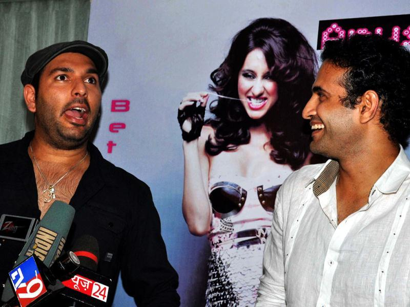 Yuvraj Singh and Irfan Pathan interact with the media.
