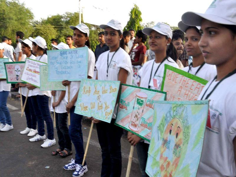 School students hold placards about environment as Rajasthan tourism minister Bina Kak flags off a cycle rally on the occasion of World Environment Day in Jaipur. World Environment Day is celebrated June 5 every year by the United Nations to stimulate worldwide awareness of environmental issues. UNI