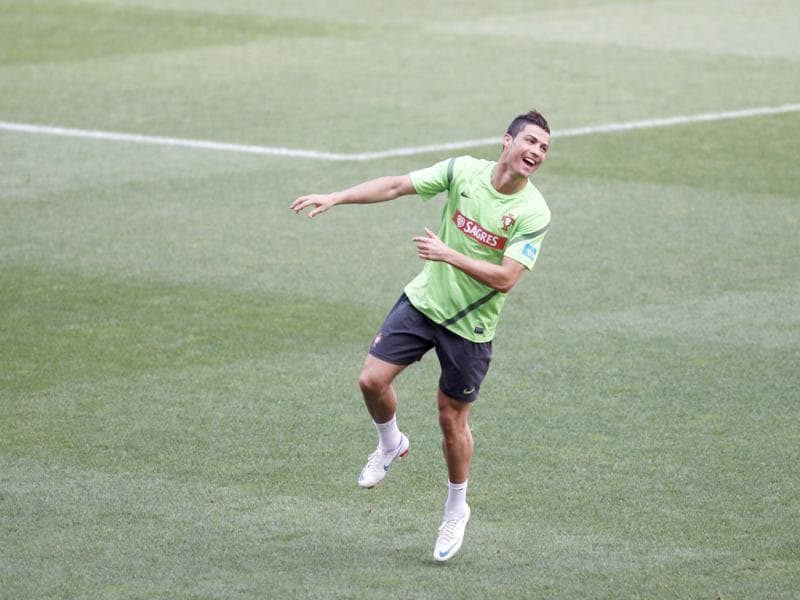 Portugal's soccer player Cristiano Ronaldo jokes during a training session at Luz stadium in Lisbon, in preparation for the Euro 2012. REUTERS/Rafael Marchante (PORTUGAL - Tags: SPORT SOCCER)
