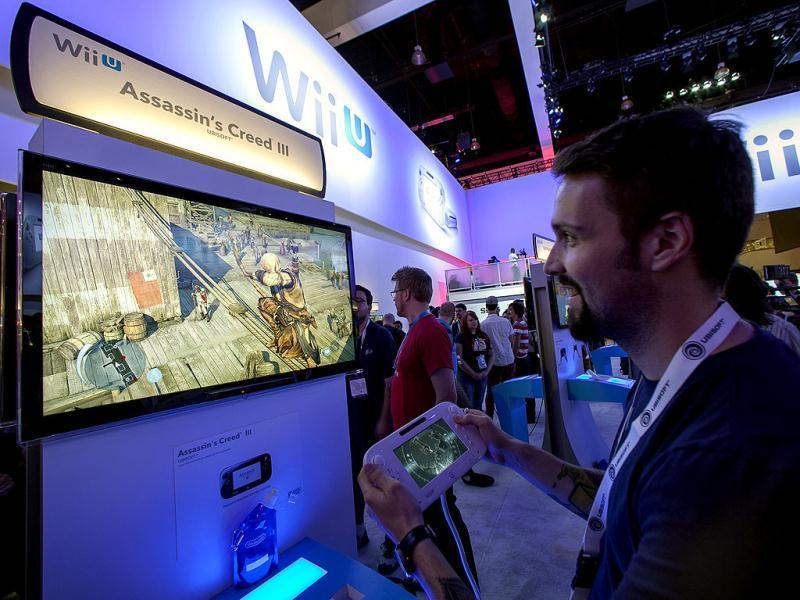 Nicolas Duclos, developer with Ubisoft Entertainment showcases the new Assassin's Creed III video game on the Nintendo Wii U console in Los Angeles. AP/Damian Dovarganes