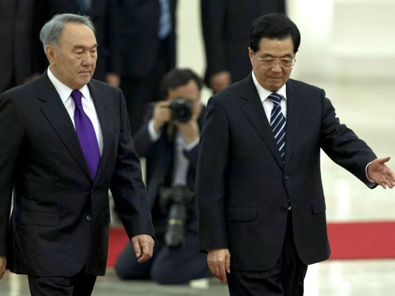 Chinese President Hu Jintao, right, ushers Kazakstan's President Nursultan Nazarbayev during a welcoming ceremony at the Great Hall of the People in Beijing, China. AP/Alexander F Yuan
