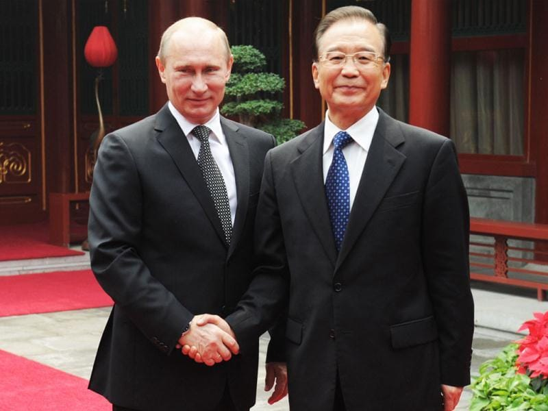 Russia's President Vladimir Putin and Chinese Prime Minister Wen Jiabao shake hands with during their meeting in Beijing. AFP/Pool
