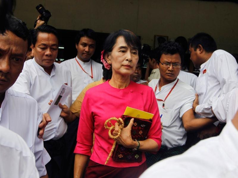 Myanmar's pro-democracy leader Aung San Suu Kyi leaves after a news conference about her Thailand and Europe trip at the National League for Democracy head office in Yangon. Reuters/Soe Zeya Tun