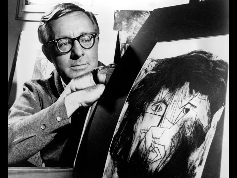 (File) Science fiction writer Ray Bradbury looks at a picture that was part of a school project to illustrate characters in one of his dramas in Los Angeles. Bradbury, who wrote everything from science-fiction and mystery to humour, died in Southern California aged 91. AP photo