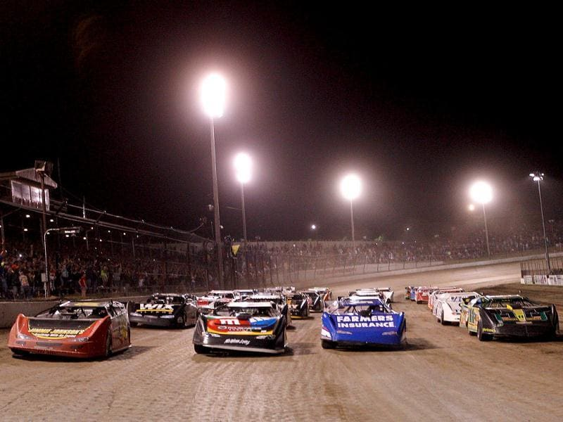 Drivers line up four wide before the Feed the Children Prelude to the Dream at Eldora Speedway in Rossburg, Ohio. AFP Photo