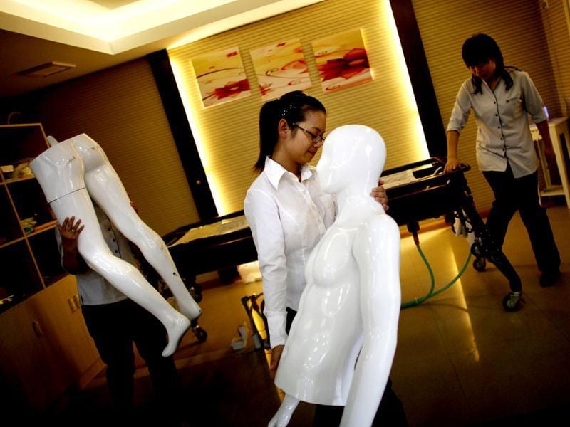 Students carry pieces of a plastic mannequin during their undertaker service class at the Tianquanjiajing Funeral Service school in Jiaxing, Zhejiang province. There are more than 1,500 students across the country studying to become undertakers each year. Courses in funeral services take three years to complete and the service includes washing of the dead body as well as providing funeral make-up and dressing. (Reuters)