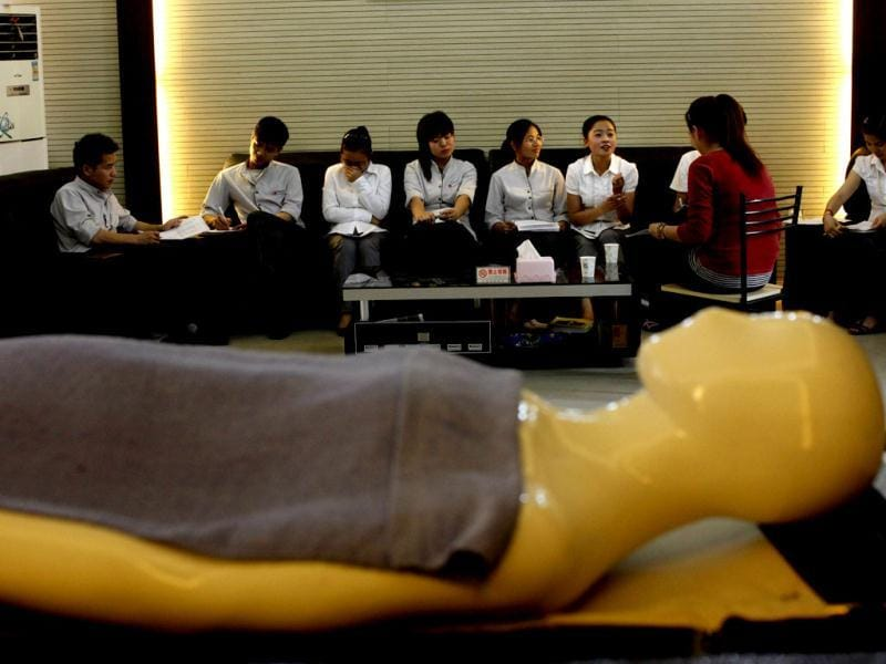 Students attend an undertaker service class at the Tianquanjiajing Funeral Service school in Jiaxing, Zhejiang province. A new breed of young Chinese undertakers are fighting centuries-old taboos to gain social acceptance for their profession, saying they help the deceased and their families make their final parting with respect. (Reuters)
