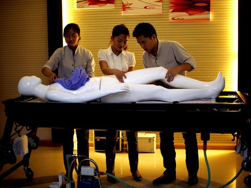 Students practice with a plastic mannequin during an undertaker service class at the Tianquanjiajing Funeral Service school in Jiaxing, Zhejiang province. A new breed of young Chinese undertakers are fighting centuries-old taboos to gain social acceptance for their profession, saying they help the deceased and their families make their final parting with respect. (Reuters)