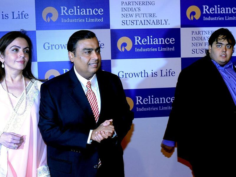 Chairman of Reliance Industries Limited Mukesh Ambani arrives for the company's annual general meeting with his wife Nita and son Anant in Mumbai. AFP/Indranil Mukherjee