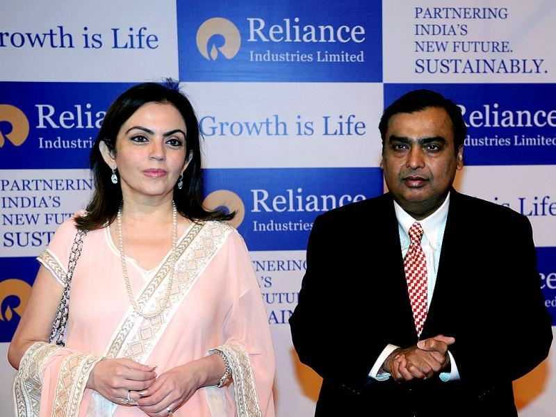 Chairman of Reliance Industries Limited Mukesh Ambani arrives for the company's annual general meeting with his wife Nita in Mumbai. Controlled by the elder of the two Ambani brothers, shares of Reliance Industries are held by one out of every four investors. AFP/Indranil Mukherjee
