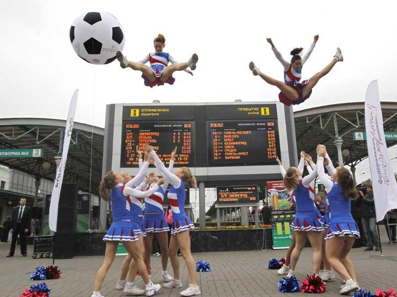 Russian cheerleaders perform to mark the departure of a special soccer fans' train from Moscow, Russia to Poland to attend the Euro 2-12 soccer tournament. AP/Misha Japaridze