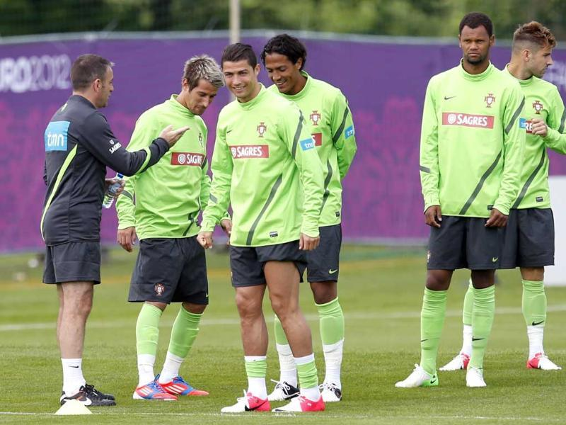 Head coach Paulo Bento, left, talks to players Fabio Coentrao, Cristiano Ronaldo, Bruno Alves, Rolando and Miguel Veloso, from left, during a training session of Portugal at the Euro 2012 soccer championship in Opalenica, Poland. AP/Armando Franca