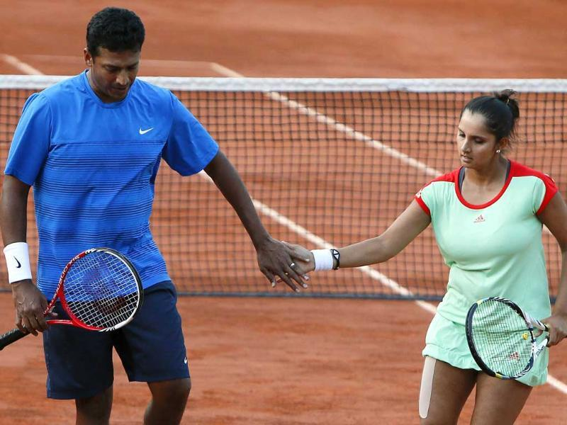 Sania Mirza and Mahesh Bhupathi (L) celebrate after a point as they play against Poland's Klaudia Jans-Ignacik and Mexico's Santiago Gonzalez during their mixed doubles final of the French Open tennis tournament at the Roland Garros stadium in Paris. AFP/Kenzo Tribouillard