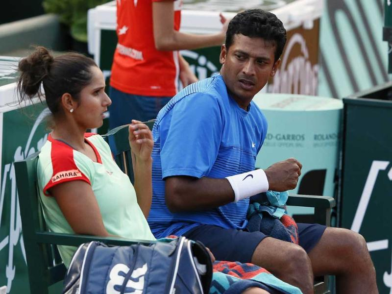 Sania Mirza and Mahesh Bhupathi (R) talk during a game break as they play against Poland's Klaudia Jans-Ignacik and Mexico's Santiago Gonzalez during their mixed doubles final match of the French Open tennis tournament. AFP/Kenzo Tribouillard