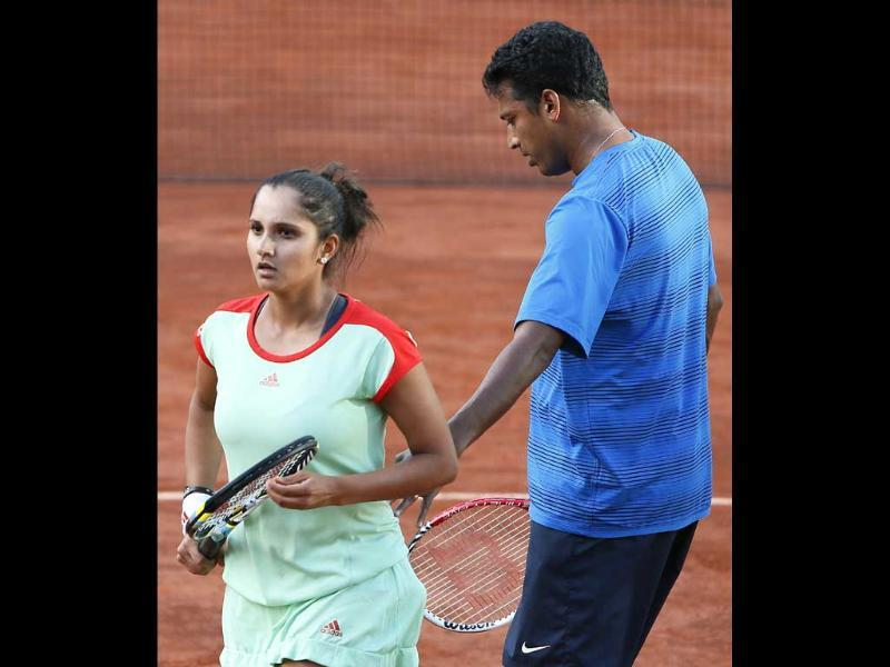 Sania Mirza and Mahesh Bhupathi (R) react after a point as they play against Poland's Klaudia Jans-Ignacik and Mexico's Santiago Gonzalez at the Roland Garros stadium in Paris. AFP/Kenzo Tribouillard