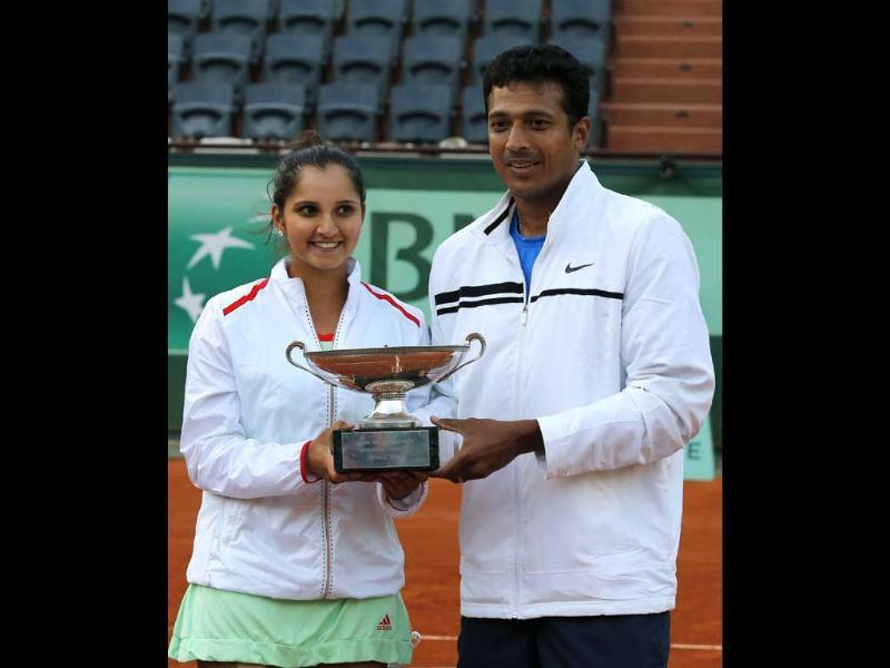 Sania Mirza, left, and Mahesh Bhupathi hold their cup after defeating Poland's Klaudia Jans-Ignacik and Mexico's Santiago Gonzalez in their mixed doubles final of the French Open tennis tournament in Paris. The Indian pair won 7-6, 6-1. AP/Michel Euler