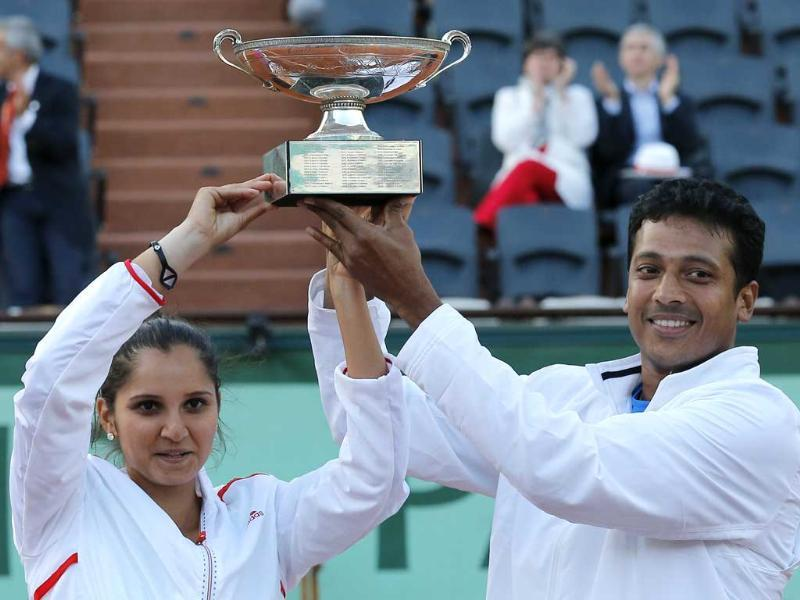 Sania Mirza, left, and Mahesh Bhupathi hold their cup after defeating Poland's Klaudia Jans-Ignacik and Mexico's Santiago Gonzalez in their mixed doubles final match of the French Open tennis tournament at the Roland Garros stadium in Paris. The Indian pair won 7-6, 6-1. AP/Michel Euler