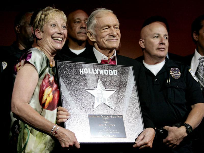 Hugh Hefner, founder, editor-in-chief and creative officer of Playboy, poses with community advocate Laurie Goldman and others as he is honored with the Hollywood Distinguished Service Award in Memory of Johnny Grant in Hollywood, California. Reuters/Jason Redmond