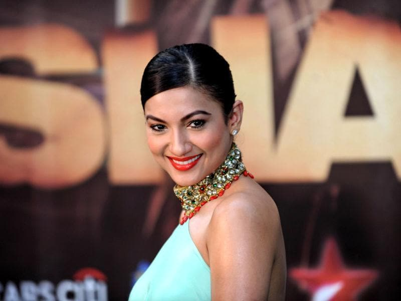 Actor Gauhar Khan strikes a pose as she arrives for the premiere.
