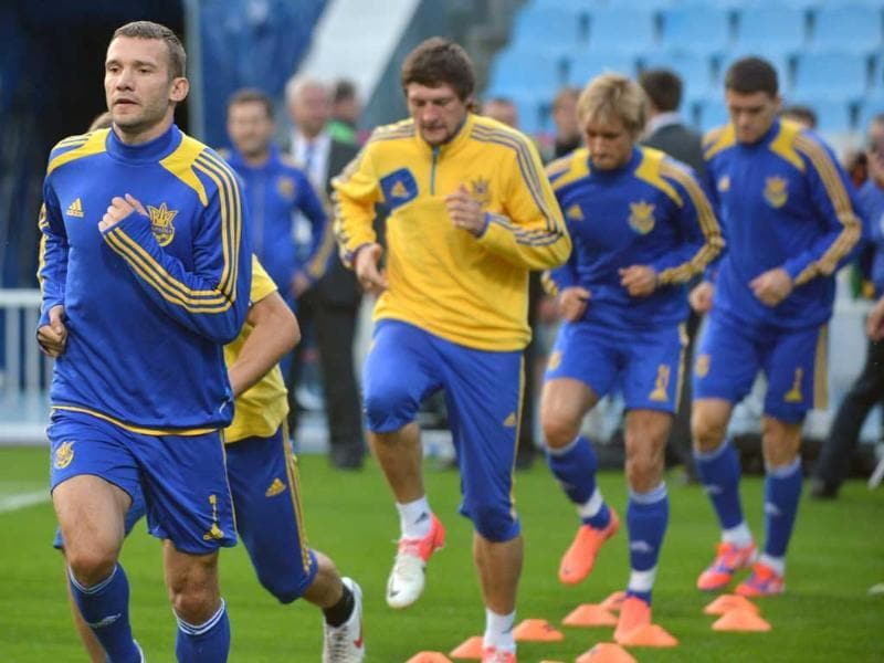 Handsome host: Ukraine's national team forward Andriy Shevchenko (L) with team mates during a training session. AFP/Sergei Supinsky