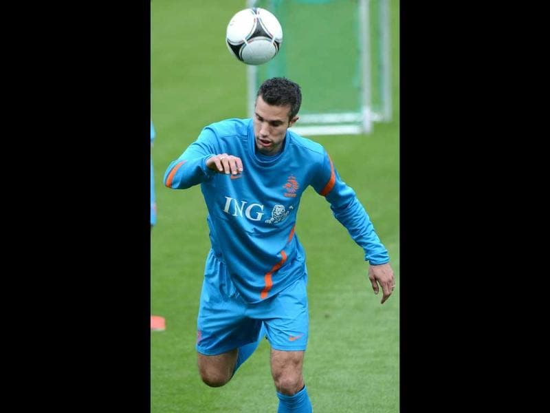 Oranje crush: Dutch forward Robin van Persie is hitting all the right notes this season. AFP/Anne-Christine Poujoulat