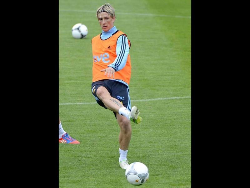 Babyface charm: Spanish forward Fernando 'El Nino' Torres kicks a ball. Can he blow away the competition at Euro 2012? AFP/Pierre-Philippe Marcou