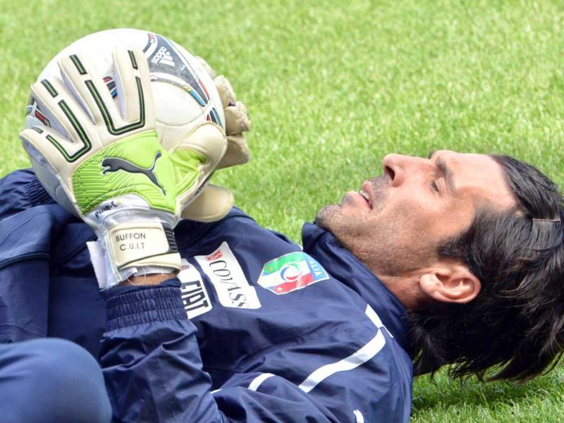 Gaga over Gigi: Italian goalkeeper Gianluigi Buffon has always been good with his hands. AFP/Giuseppe Cacace