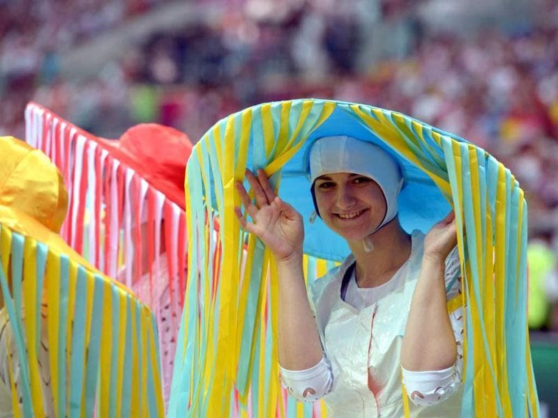 A performer poses during the opening ceremony prior to the kick off of the Euro 2012 football championships match Poland vs. Greece, on June 8, 2012 at the National Stadium in Warsaw. (AFP Photo/Gabriel Bouys)