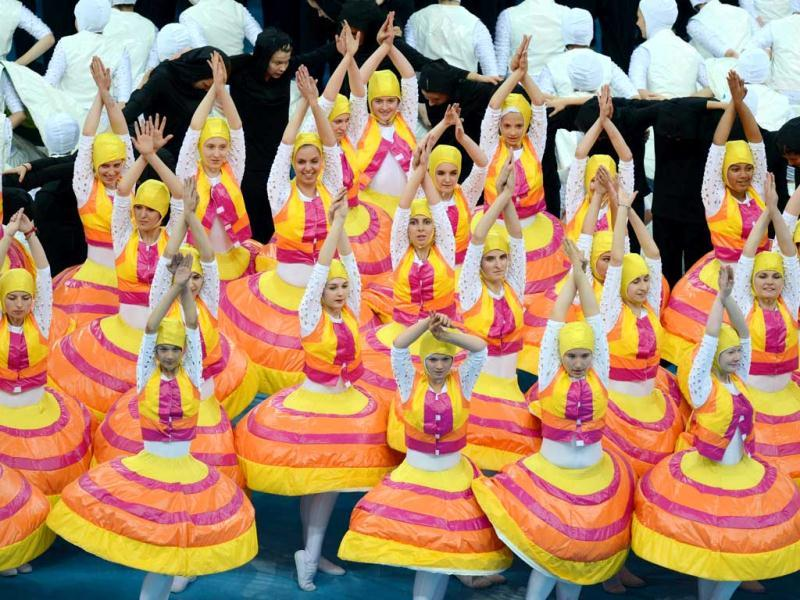 Dancers perform during the opening ceremony ahead of the Euro 2012 football championships match at the National Stadium in Warsaw. (AFP Photo/Janek Skarzynski)