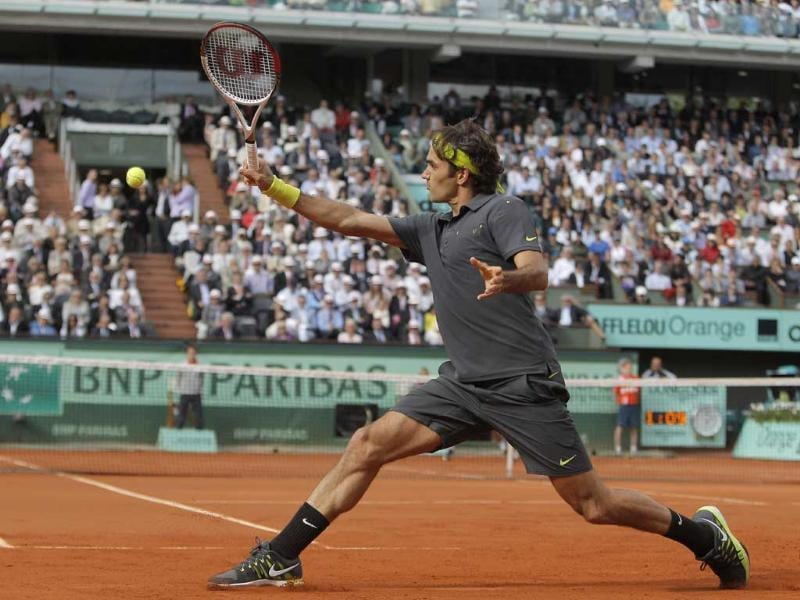 Roger Federer returns in his semi final match against Novak Djokovic of Serbia at the French Open tennis tournament in Roland Garros stadium in Paris. AP/Michel Spingler