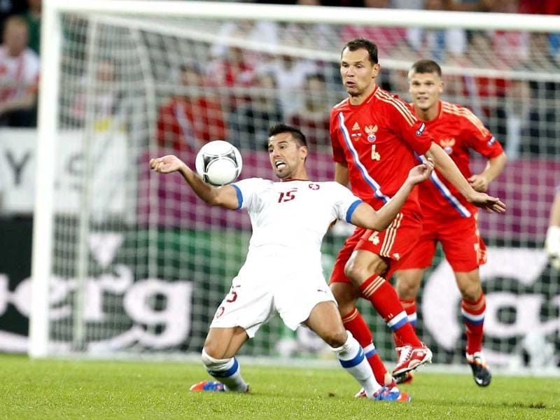 Czech Republic's Milan Baros stops the ball in front of Russia's Sergei Ignashevich during the Euro 2012 soccer championship Group A match between Russia and Czech Republic in Wroclaw, Poland. AP/Jon Super