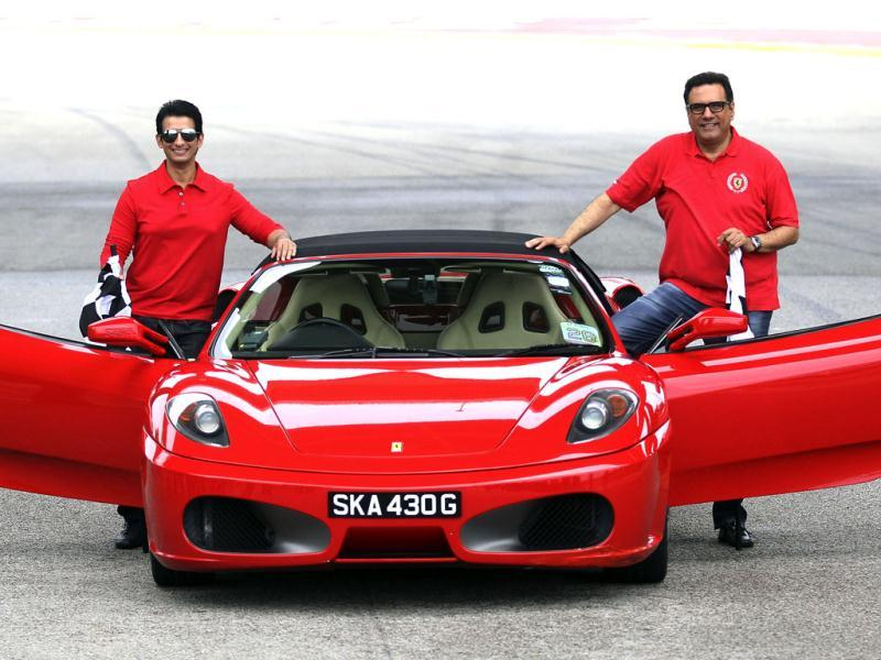 The actors pose with the Ferrari.