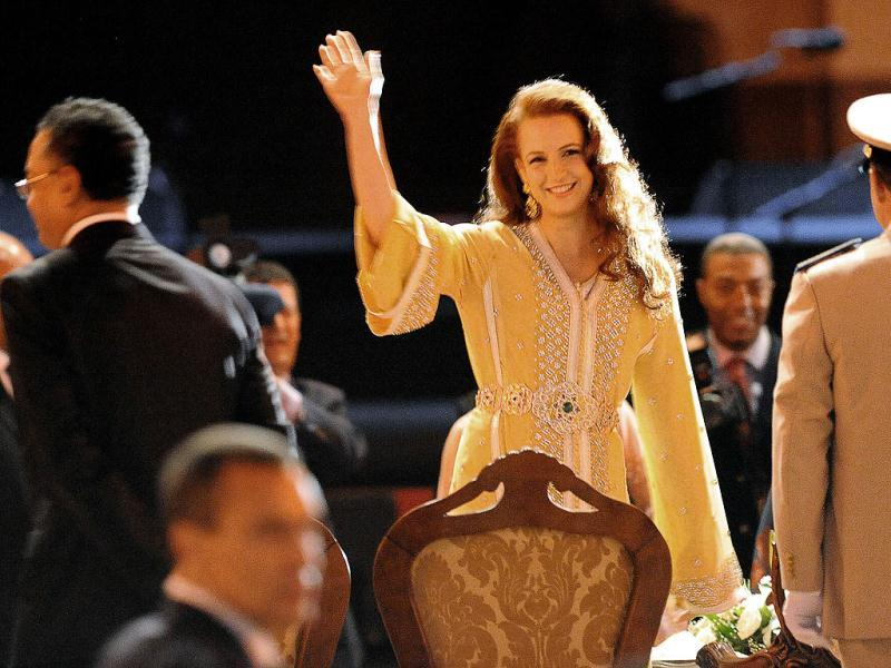Morocco's Princess Lalla Salma, wife of King Mohammed VI, waves at the crowd during the opening ceremony of the 18th World Sacred Music Festival in Fes, Morocco . AFP photo/Abdelhak Senna