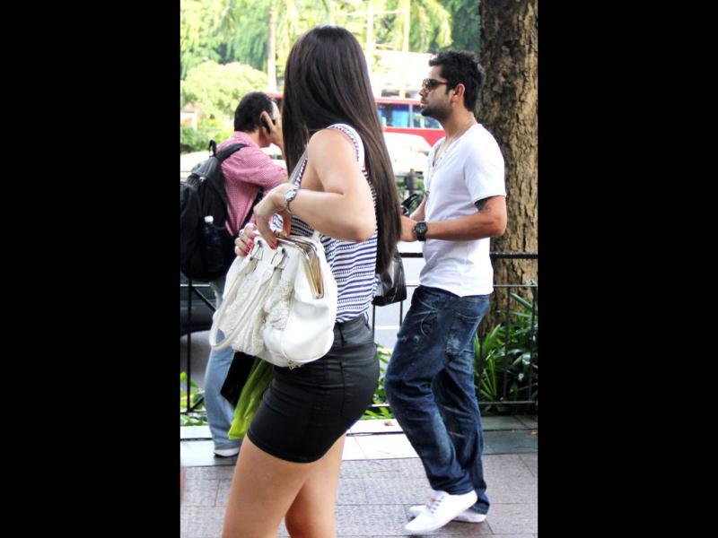 While Virat Kohli turned away from the cameras, the girl hastily entered a shopping mall. We wonder what's cooking?